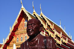 Monk's statue in front of a viharn Royalty Free Stock Image