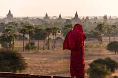 A Monk`s view over Bagan. A burmese monk looks over the pagdodas of Bagan, Pyathada Temple in Bagan, Myanmar Stock Image