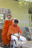 Monk shave man's hair before buddhist monk ordination ceremony Royalty Free Stock Photography