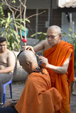 Monk shave man's hair before buddhist monk ordination ceremony Royalty Free Stock Photos