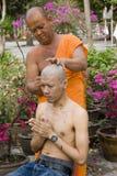 Monk shaving head Stock Photos