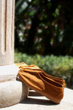 Monk shoes. Two pair of monk shoes leaning against a pillar royalty free stock photography