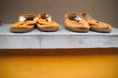 Monk shoes. Yellow budhist monk shoes by the temple Royalty Free Stock Image