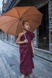 Monk at Shwenandaw Monastery in Mandalay , Myanmar. MANDALAY , MYANMAR - SEP 02 : Monk at Shwenandaw Monastery in Mandalay, Myanmar on September 02 2017 Stock Images