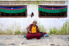 Monk sitting in prayer Royalty Free Stock Image