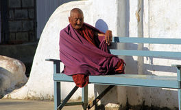 Monk sitting in the sun Royalty Free Stock Photo