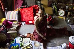 A monk smiling in his shed. Stock Photography