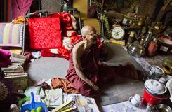 A monk smiling in his shed. Royalty Free Stock Photography