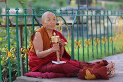 A Monk spins a karma wheel Royalty Free Stock Image