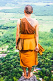 A monk standing on the mountain Royalty Free Stock Photography