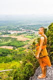 A monk standing on the mountain Stock Image