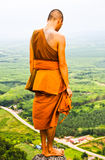 A monk standing on the mountain Royalty Free Stock Images