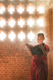 Monk standing reading scripture Royalty Free Stock Photos