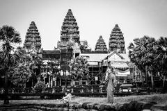 Monk stands on moat wall at Angkor Wat Temple Royalty Free Stock Images
