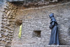 Monk statue in old town of Tallinn, Estonia. Monk statue at Danish King`s Garden, in the old town of Tallinn. The statue is made of metal and installed on the royalty free stock images
