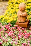 Monk statue in the garden Stock Photos