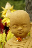 Monk statue and lotus Stock Photography