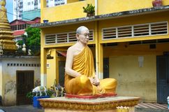 Monk statue in Phnom Penh Cambodia. Royalty Free Stock Images