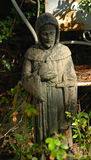 Monk Statue. A statue of a monk or priest serving as a outdoor decorative feature in near Charleston South Carolina Royalty Free Stock Image