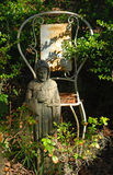 Monk Statue. A statue of a monk or priest serving as a outdoor decorative feature in near Charleston South Carolina. Picture includes a white rusty wrought iron Stock Images
