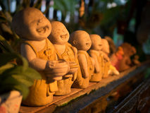Monk statues in the garden. Royalty Free Stock Photos