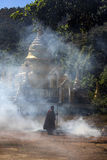 Monk burning leaves at temple - Pindaya - Myanmar Stock Image