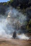 Monk burning leaves at temple - Pindaya - Myanmar Stock Image