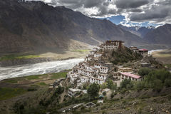 A monk taking picture of Kye monastery or ki monastery with his mobile Stock Photo