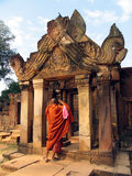 Monk taking pictures. Cambodian monk taking pictures of a temple in Agkor Royalty Free Stock Photo