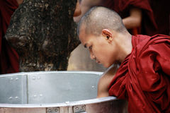 Monk taking rice from a big pan, myanmar Stock Photos