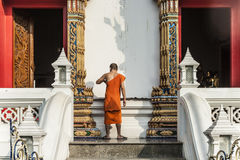 Monk in the temple Wat Thewarat at the river Mae Nam Chao Phraya Royalty Free Stock Image