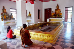 Monk and thai woman praying Buddha's footprint 4 footprints Stock Image
