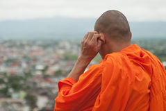 Monk. A monk in Thailand. Watch over the town Royalty Free Stock Photography