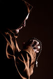 Monk with two hands clasped in prayer. Monk in robe with two hands clasped in prayer Stock Image