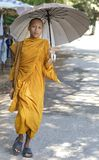 Monk with Umbrella Royalty Free Stock Photography