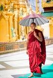Monk with umbrella Royalty Free Stock Photos