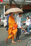 Monk with umbrella Stock Photography