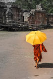 Monk with umbrella walking in the ancient temple stock photo