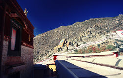 A monk walk in the Drepung Monastery Royalty Free Stock Photos