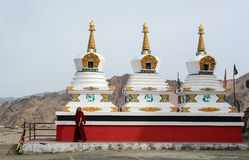 A monk walking around stupas in Ladakh, India Stock Images