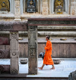 A monk walking at the Buddhist temple in Gaya, India.  Royalty Free Stock Image