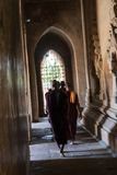 Monk walking in a hallway, Bagan. Silhouette of a monk walking in a hallway of a pagoda, Bagan. Myanmar stock image