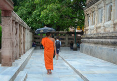 A monk walking at the Mahabodhi Temple in Gaya, India.  Royalty Free Stock Photos