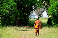 Monk walking at Prasat Nakhon Luang Temple Stock Image