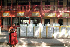 Monk walking with a rice container in the hands at Mahagandayon Royalty Free Stock Image