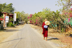 A monk is walking on the road in Bagan, Myanmar Stock Image
