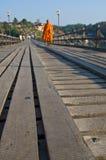 Monk walking on the wooden bridge. Monk walking on the old wooden bridge ,Sungklaburi,Thailand Stock Photos