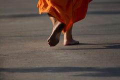 Monk walks barefoot Stock Photos