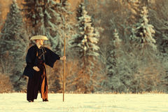 Monk warrior among snow forest Royalty Free Stock Image