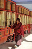 A monk was whirling prayer wheel Royalty Free Stock Image